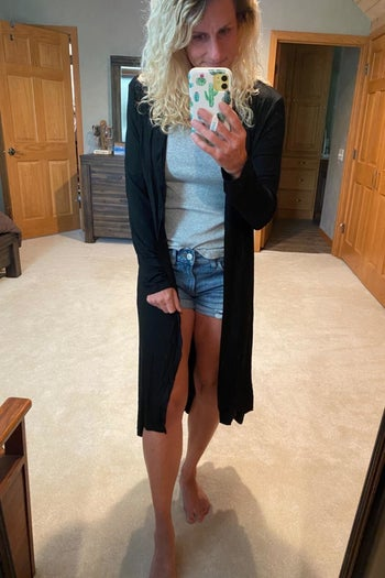 Reviewer wearing duster-style cardigan