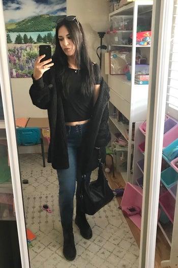Reviewer wearing black sherpa hoodie