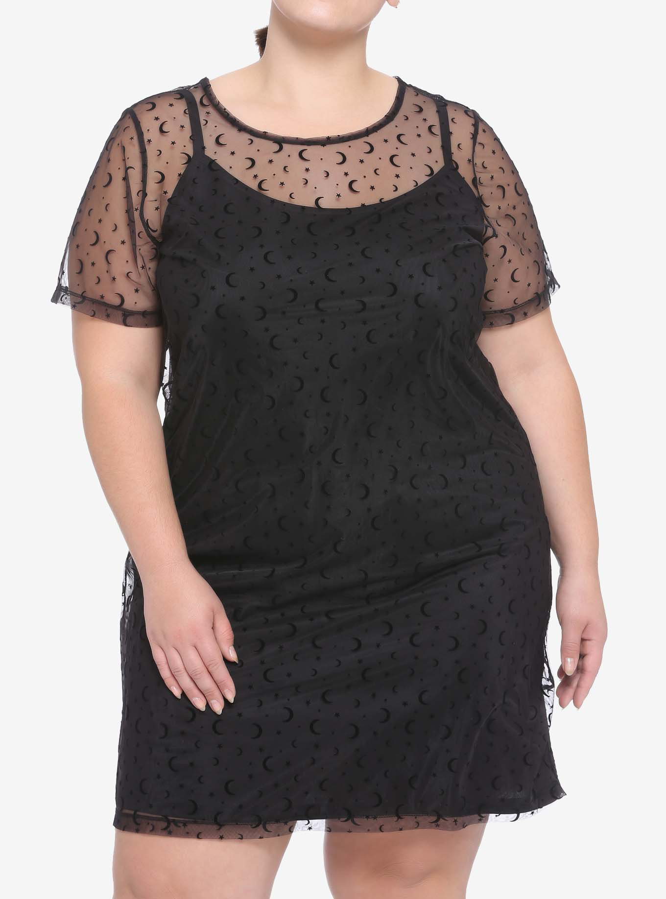 Model wearing black dress with sheer moon-and-star overlay