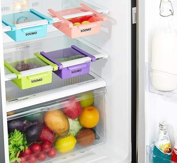The clip-on shelves pictured inside a fridge.
