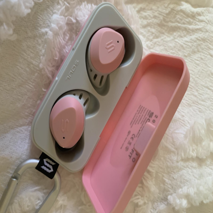The reviewer's earbuds in pink