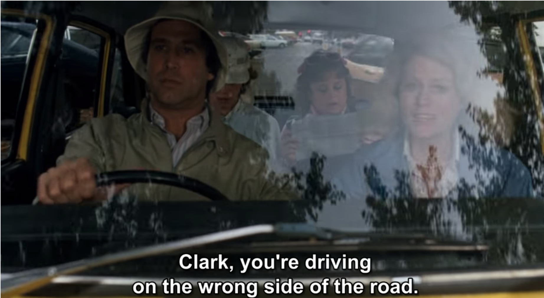 A scene from European Vacation where Clark Griswold drives on the wrong side of the road in England