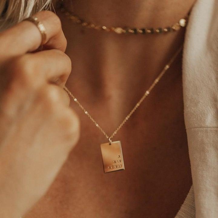 model wearing customized gold pendant