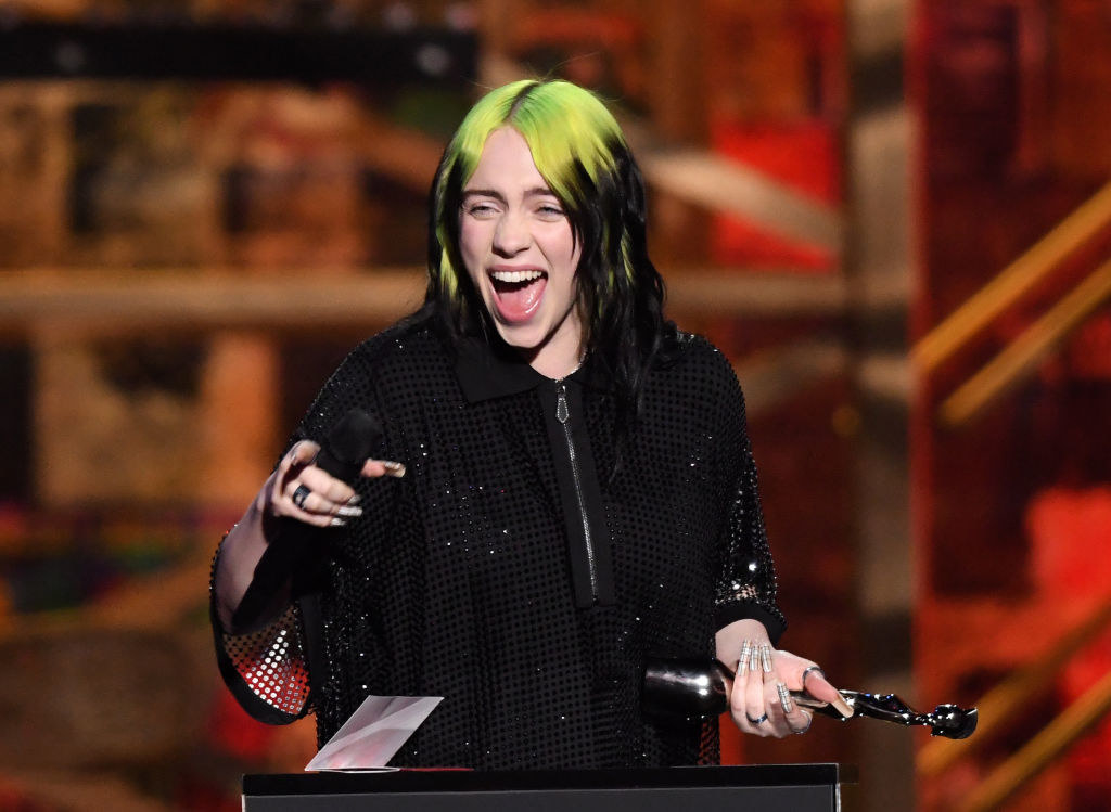 Billie laughs on stage during the 2020 BRIT Awards