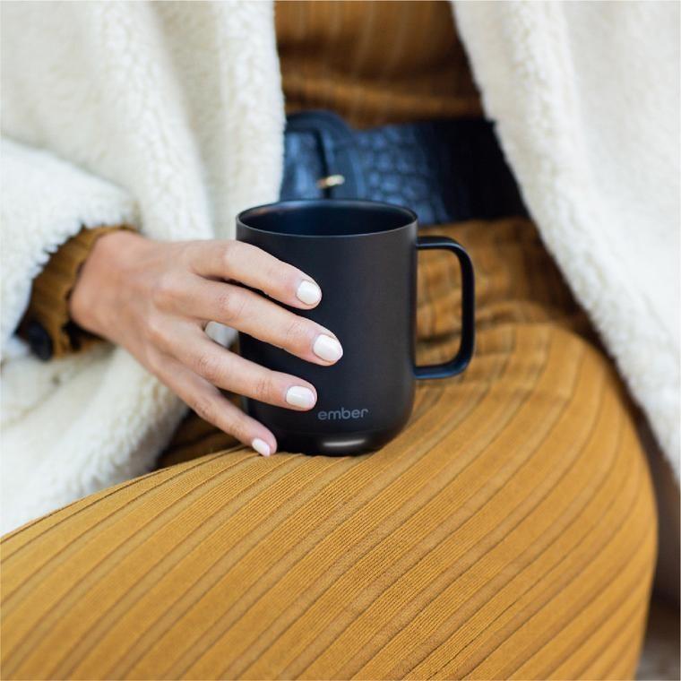 Model holding the black matte mug