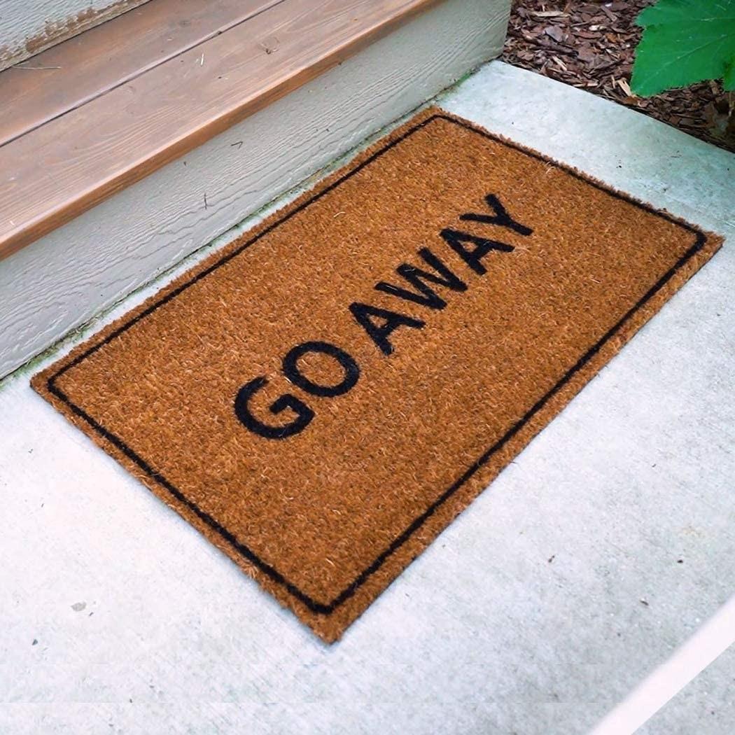 A door mat that says go away