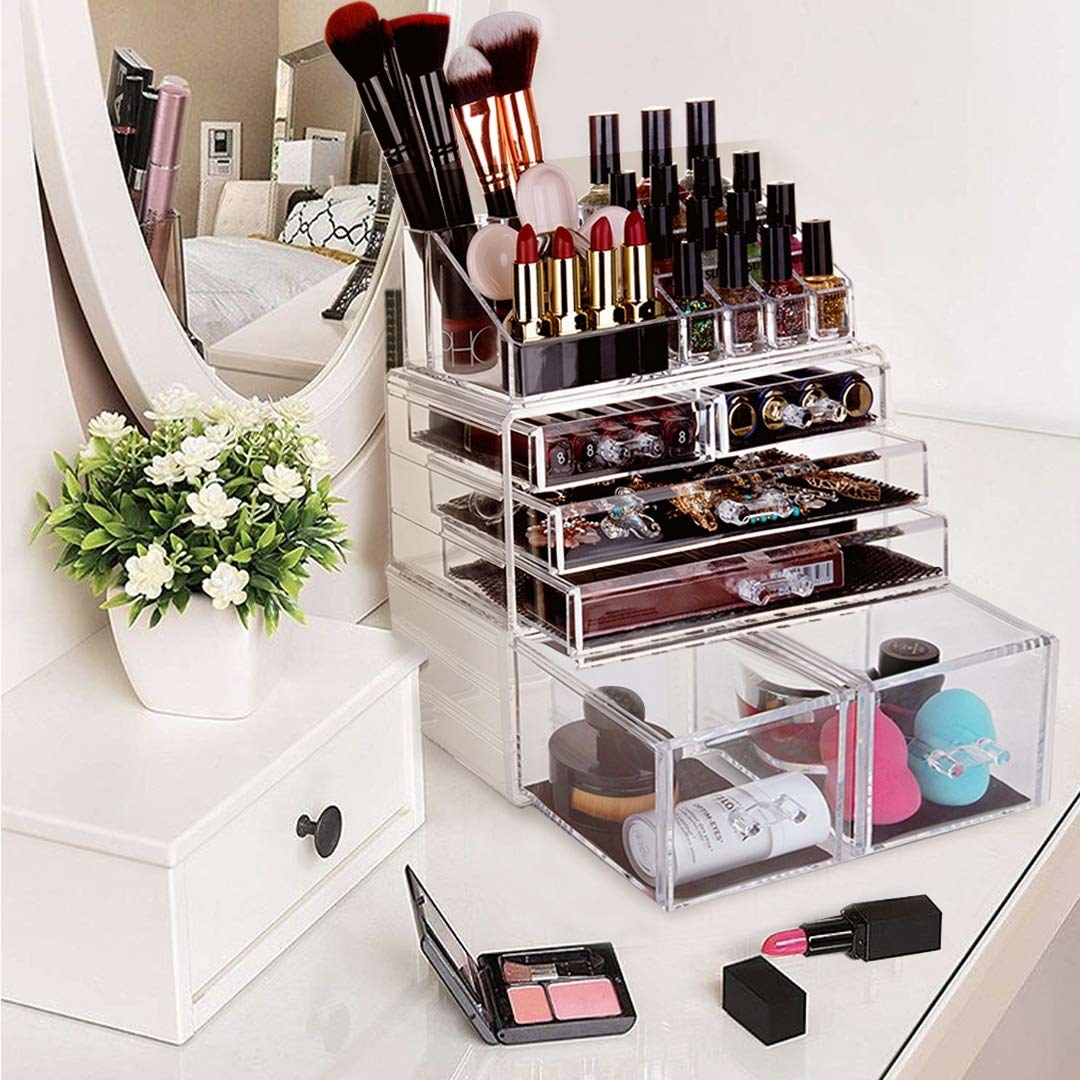 The organizer, which has four rows of drawers and a section for lipsticks, brushes, and nail polishes on top