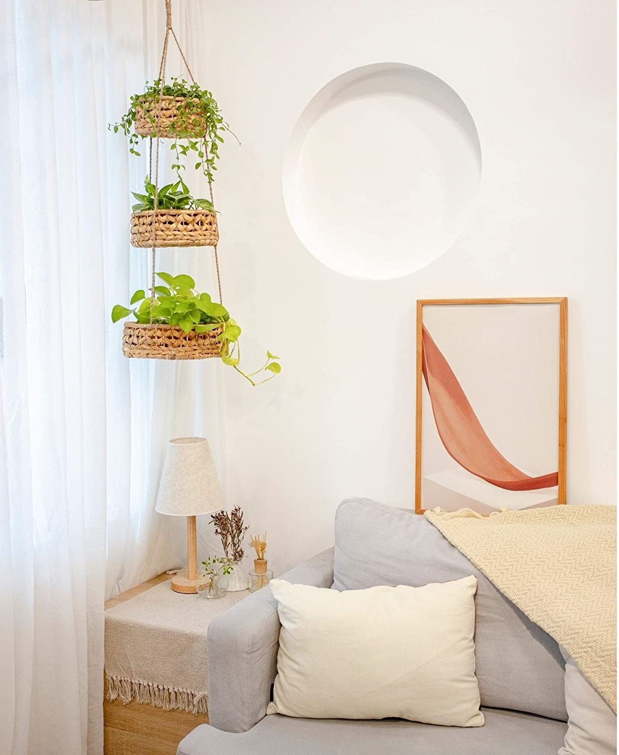 Three-tiered hanging basket filled with plants in living room