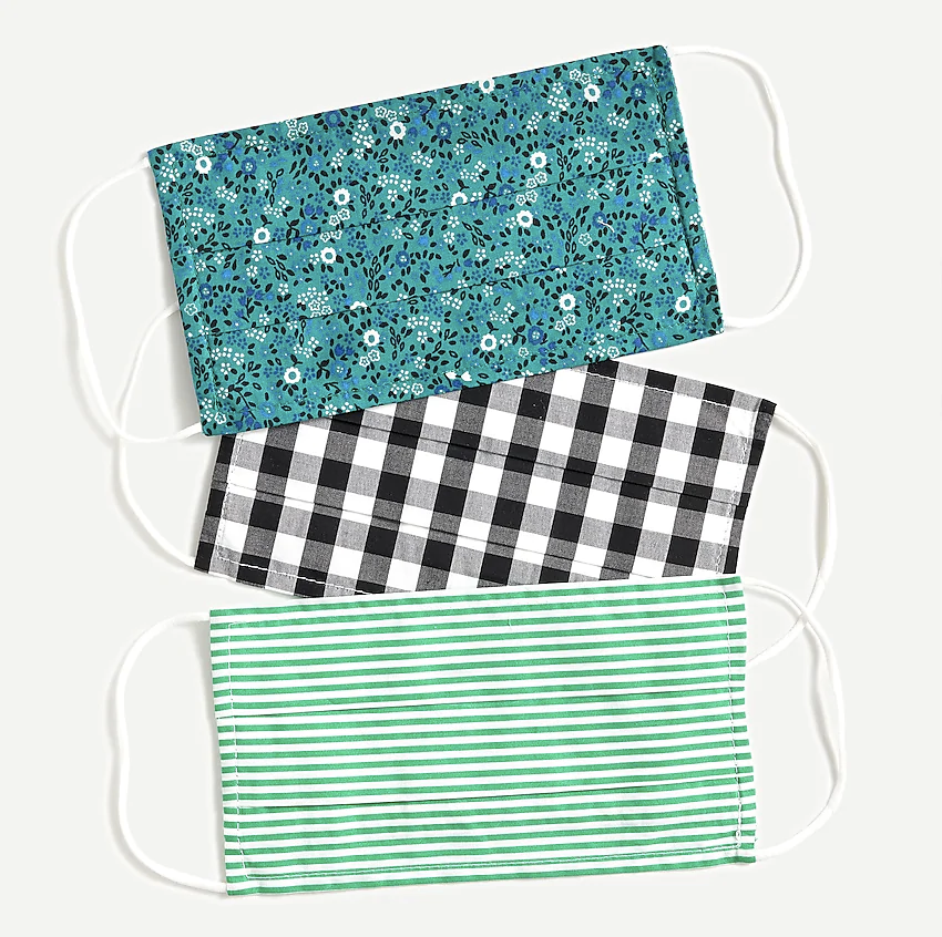 three masks in green stripe, black gingham, and green floral