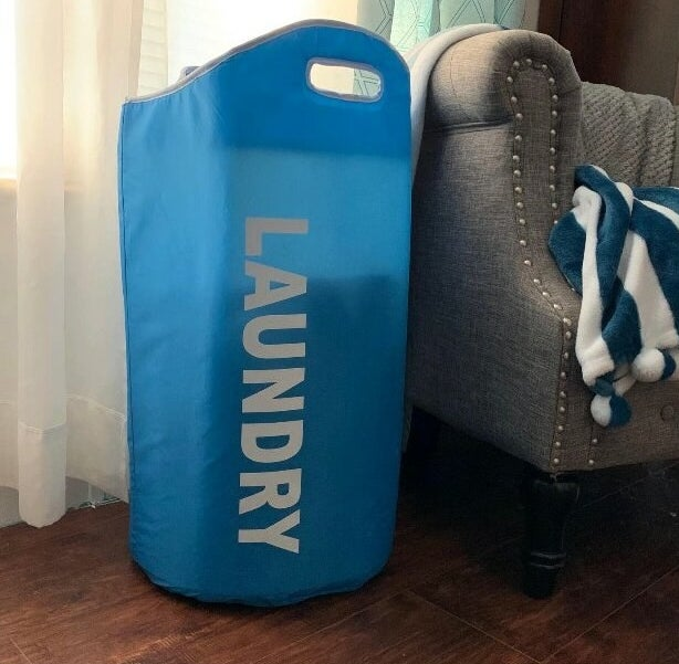 The blue laundry hamper