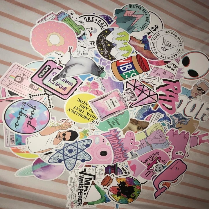 reviewer showing their stickers, which include various memes, pop culture references, and nostalgic items