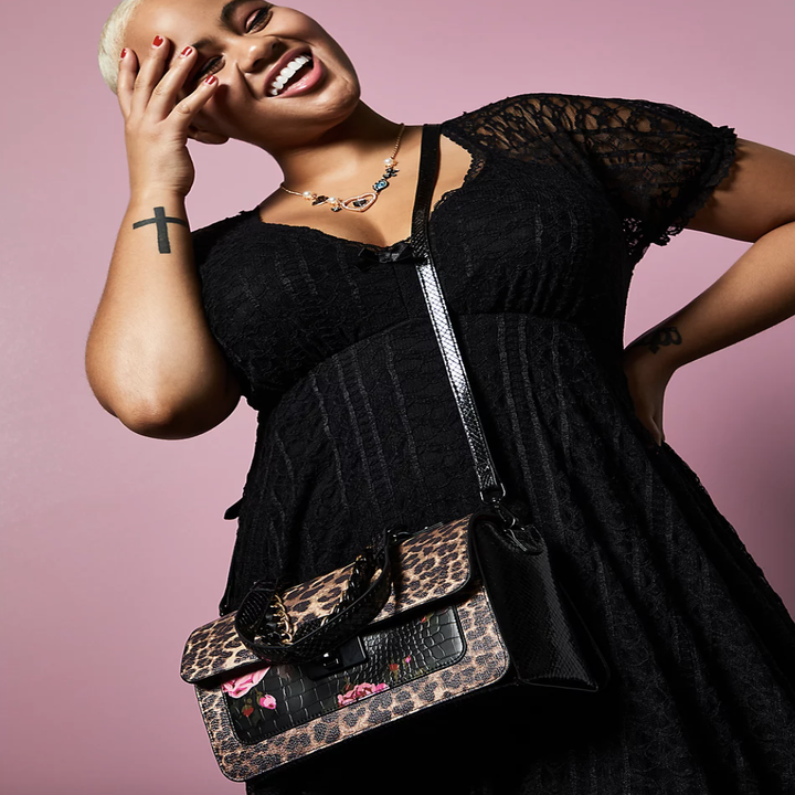 model wearing the satchel as a crossbody