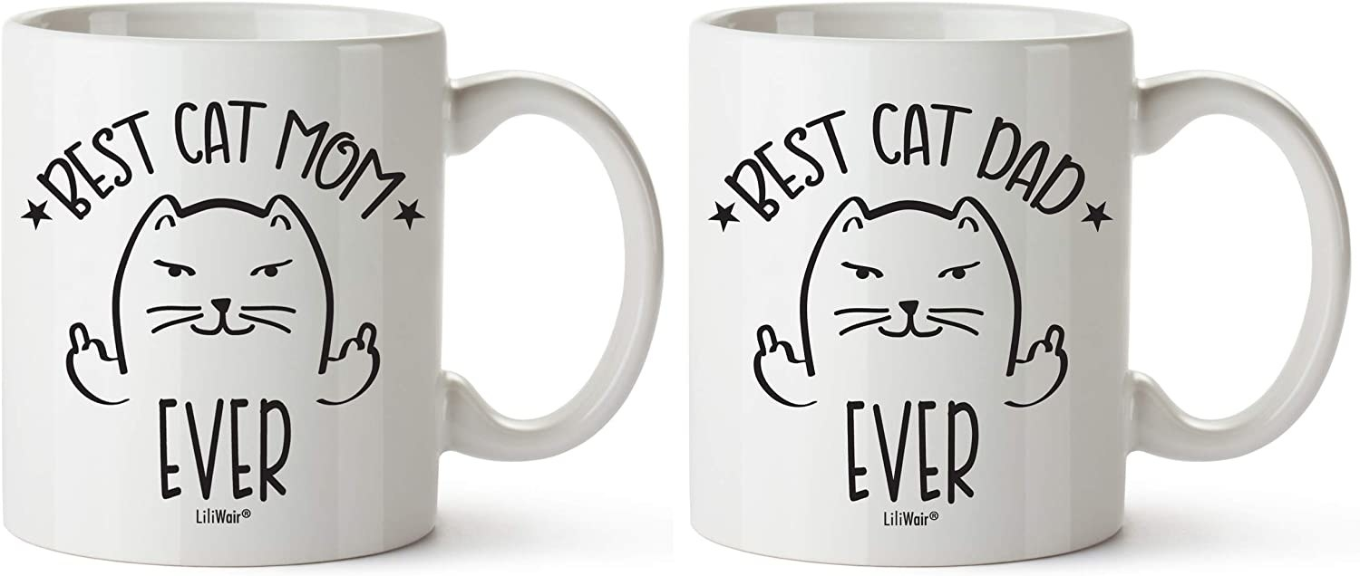 Two white mugs with a cartoon cat that say best cat mom ever and best cat dad ever