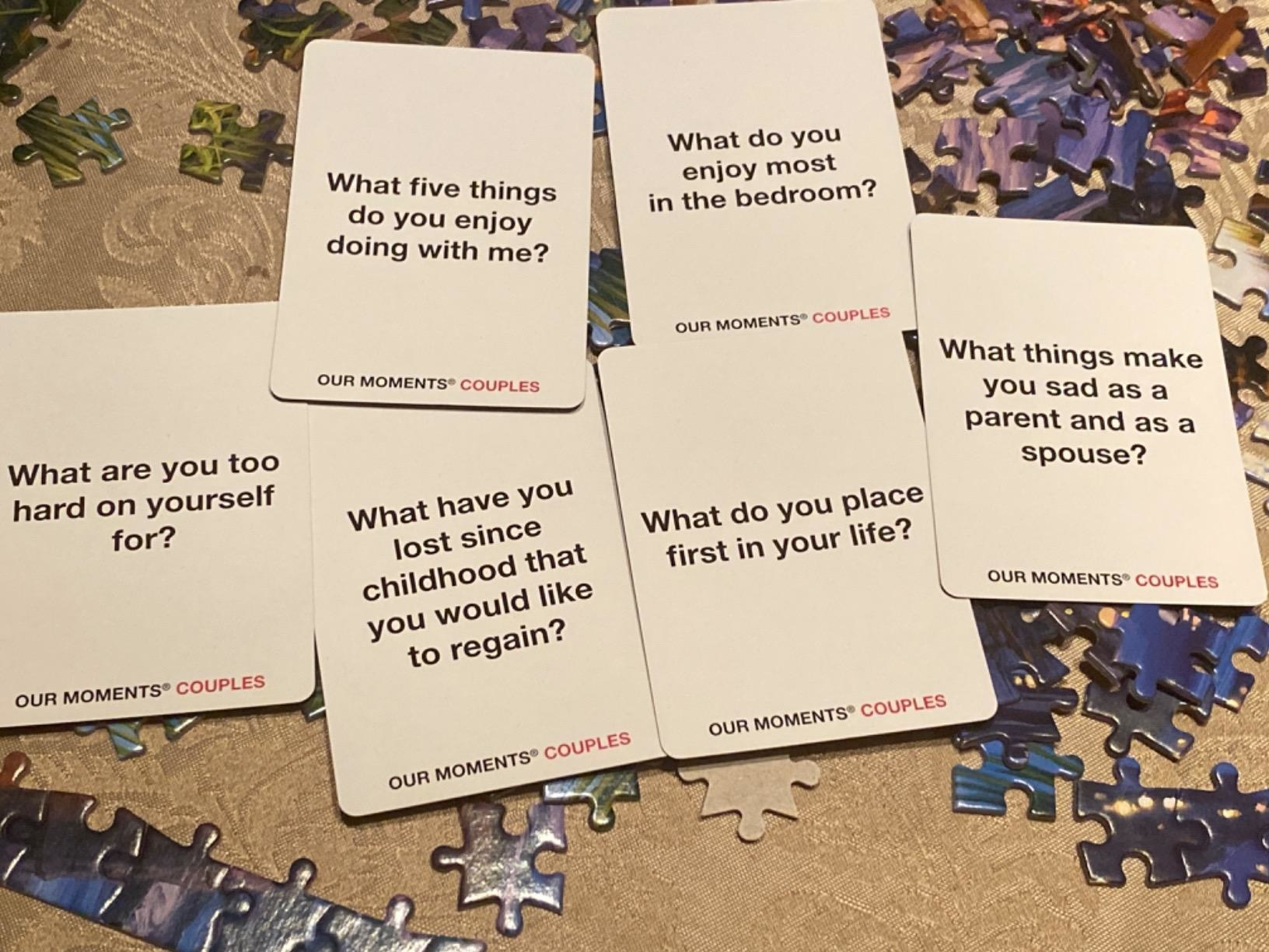 "Reviewer photo of some of the cards, which include questions like ""What are you too hard on yourself for?"" and ""What five things do you enjoy doing with me?"""
