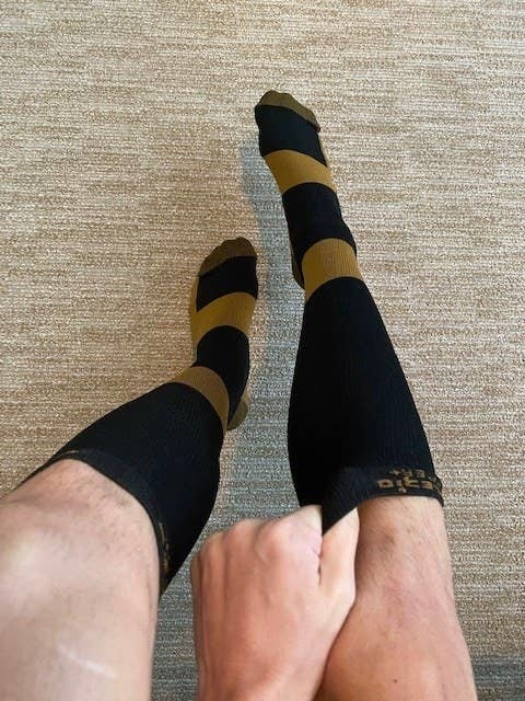 A reviewer wearing the socks
