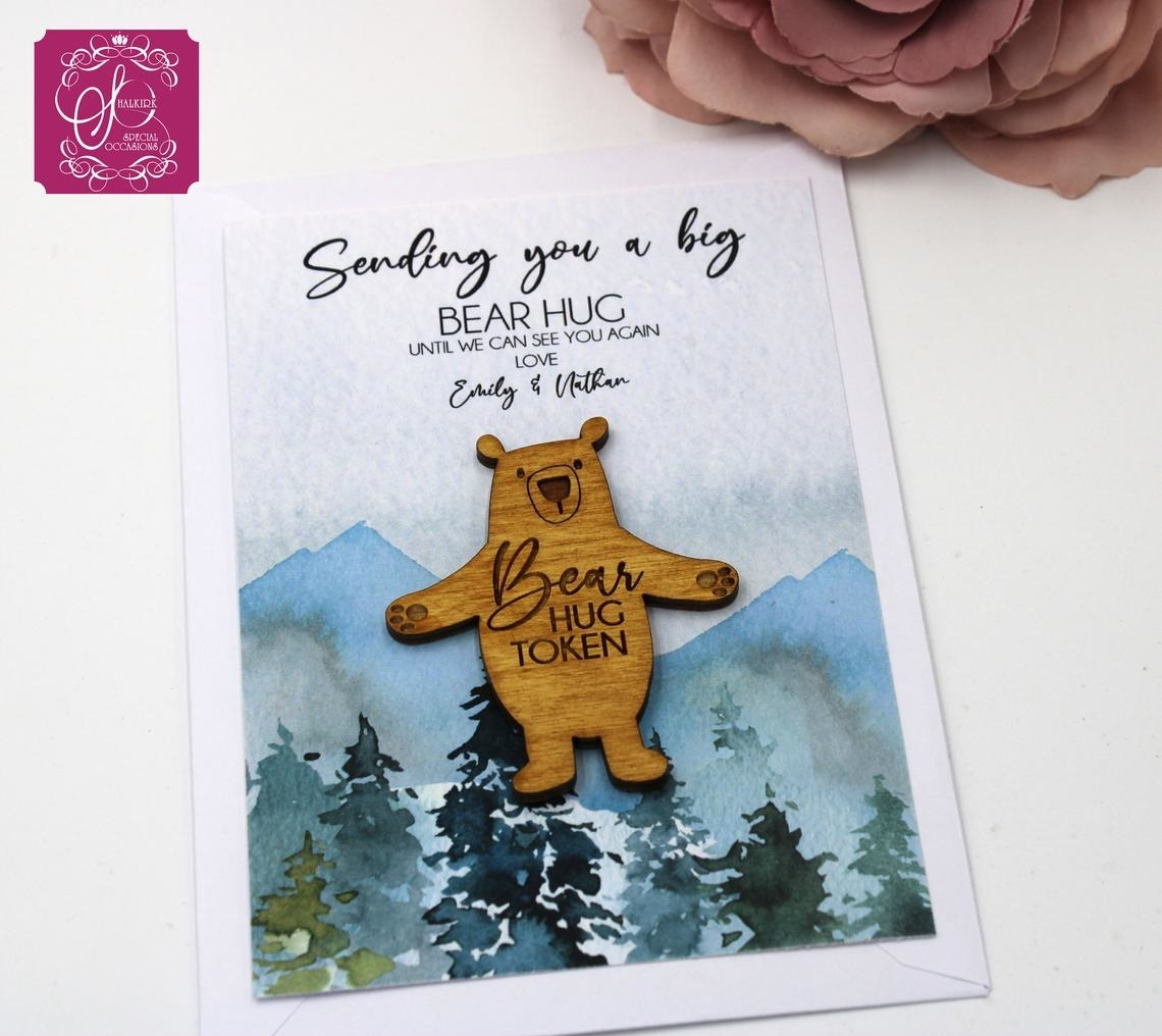 The bear hug token on a personalized notecard