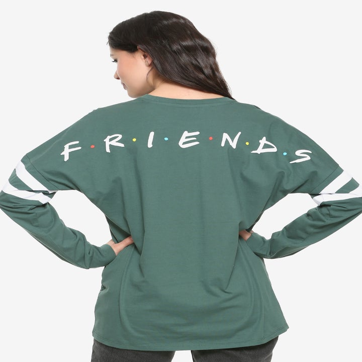 the back of the shirt with the friends logo on it