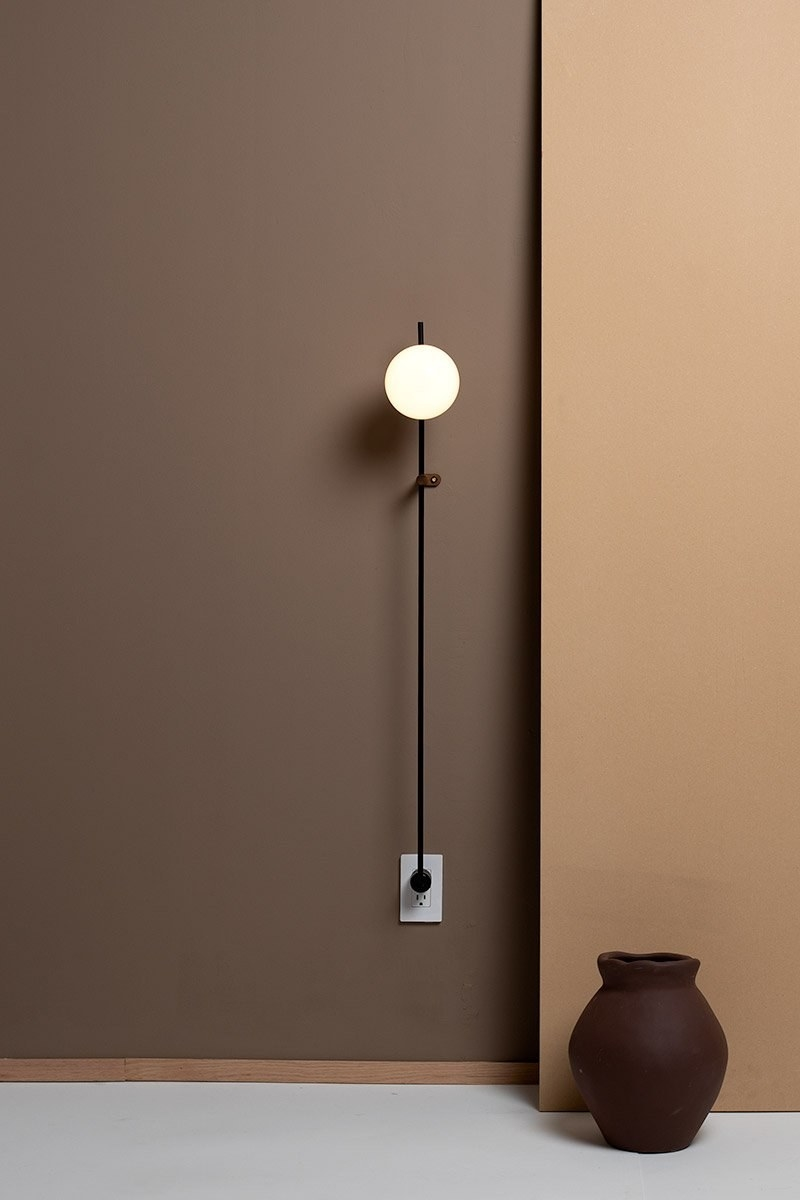 Orb light attached to wall outlet