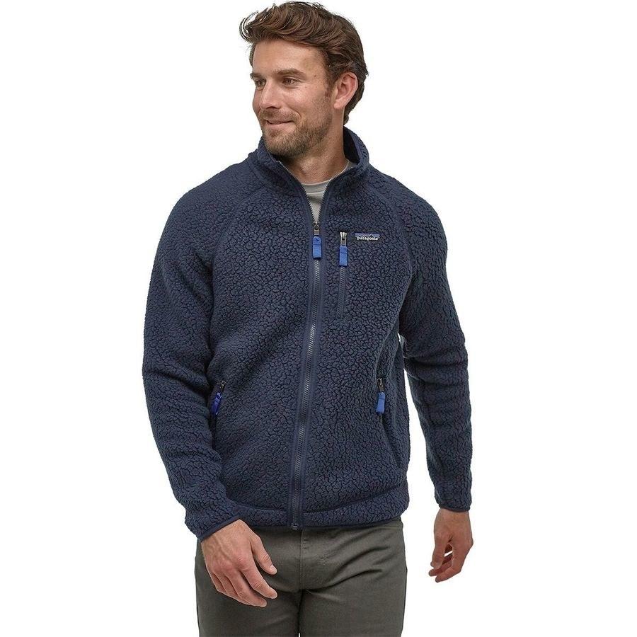 Model wearing pile-fleece navy Patagonia zip-up