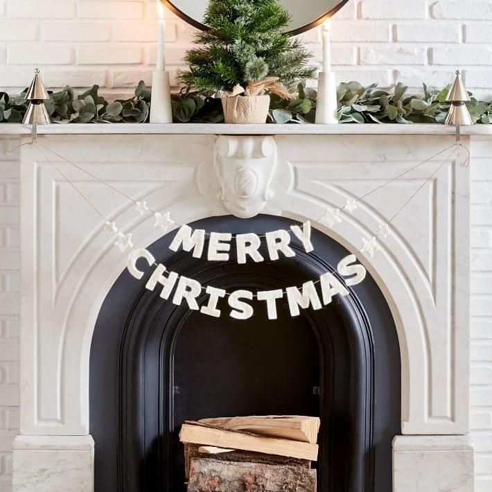 Merry Christmas garland strung across fireplace