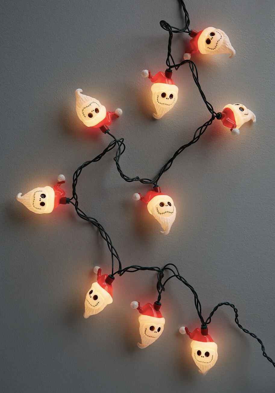 string lights shaped like jack skellingtons head with santa clothing