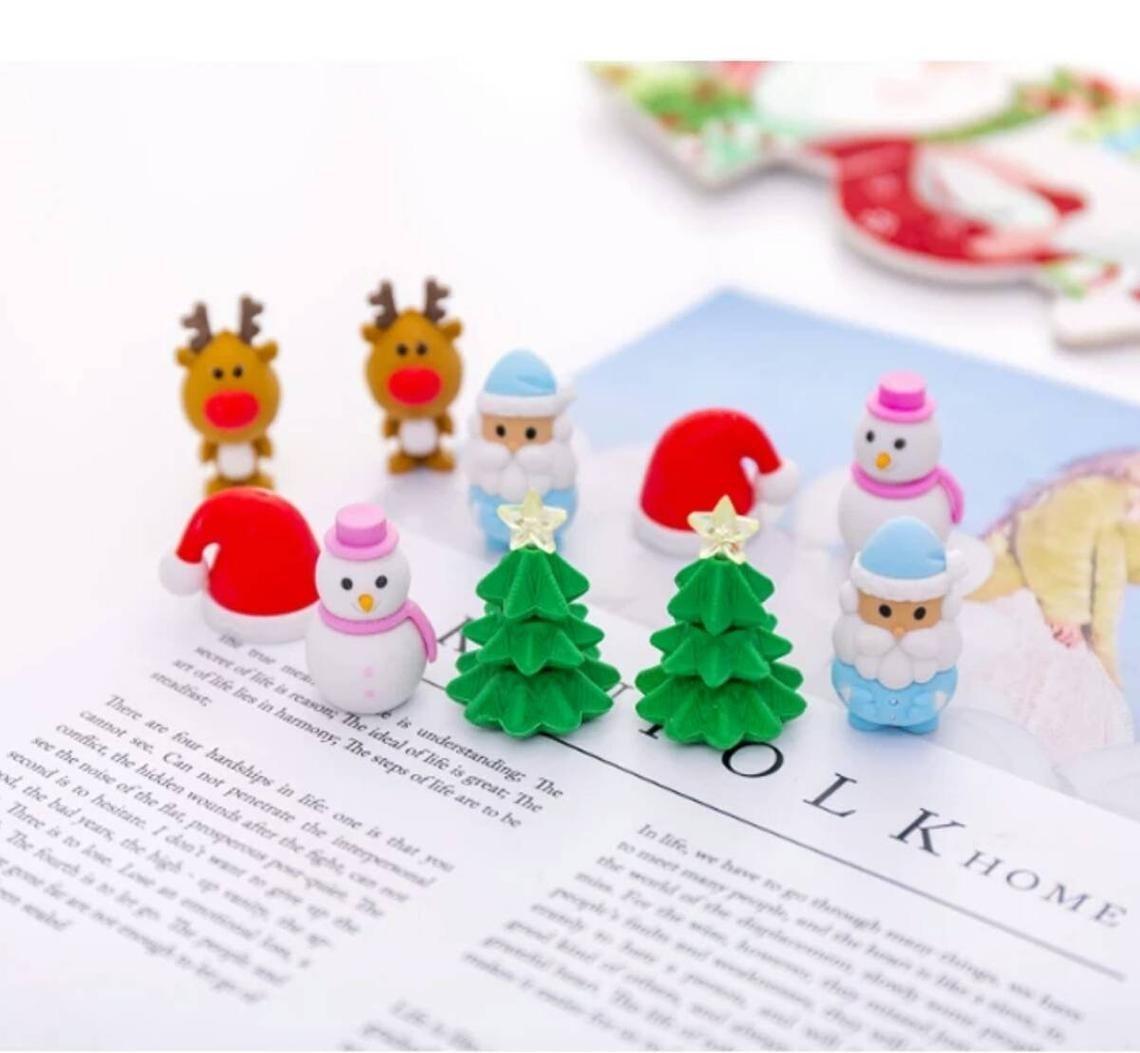 erasers that looks like christmas trees, santa hats, santas, reindeer, and snowmen