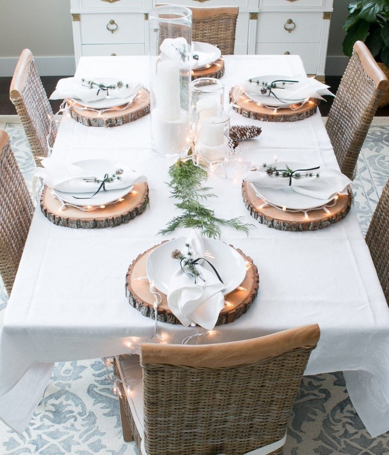 Table setting featuring wood slice place settings