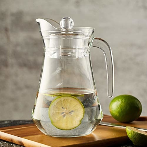 Pitcher with some water and lemon slices in it.