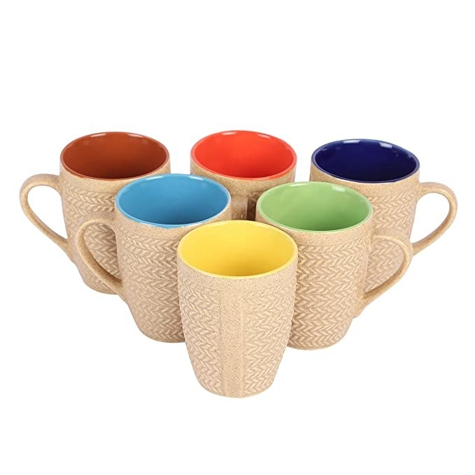 Beige ceramic mugs with different coloured insides.