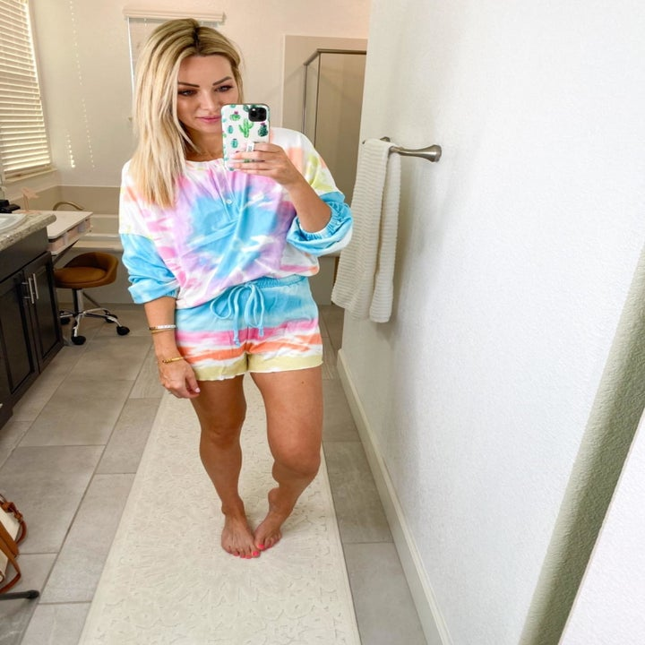 a reviewer in one of the long sleeve and shorts tie dye sets
