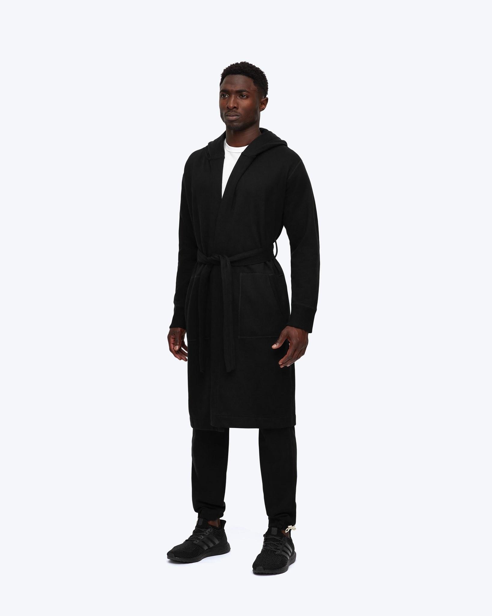 Model wearing black Reigning Champ robe