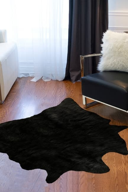 living room with calfskin shape faux fur rug on the floor