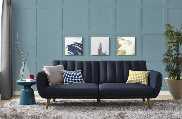 dark blue couch with throw pillows in living room