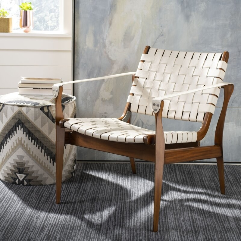 wooden chair with white leather back, seat, and arm rests
