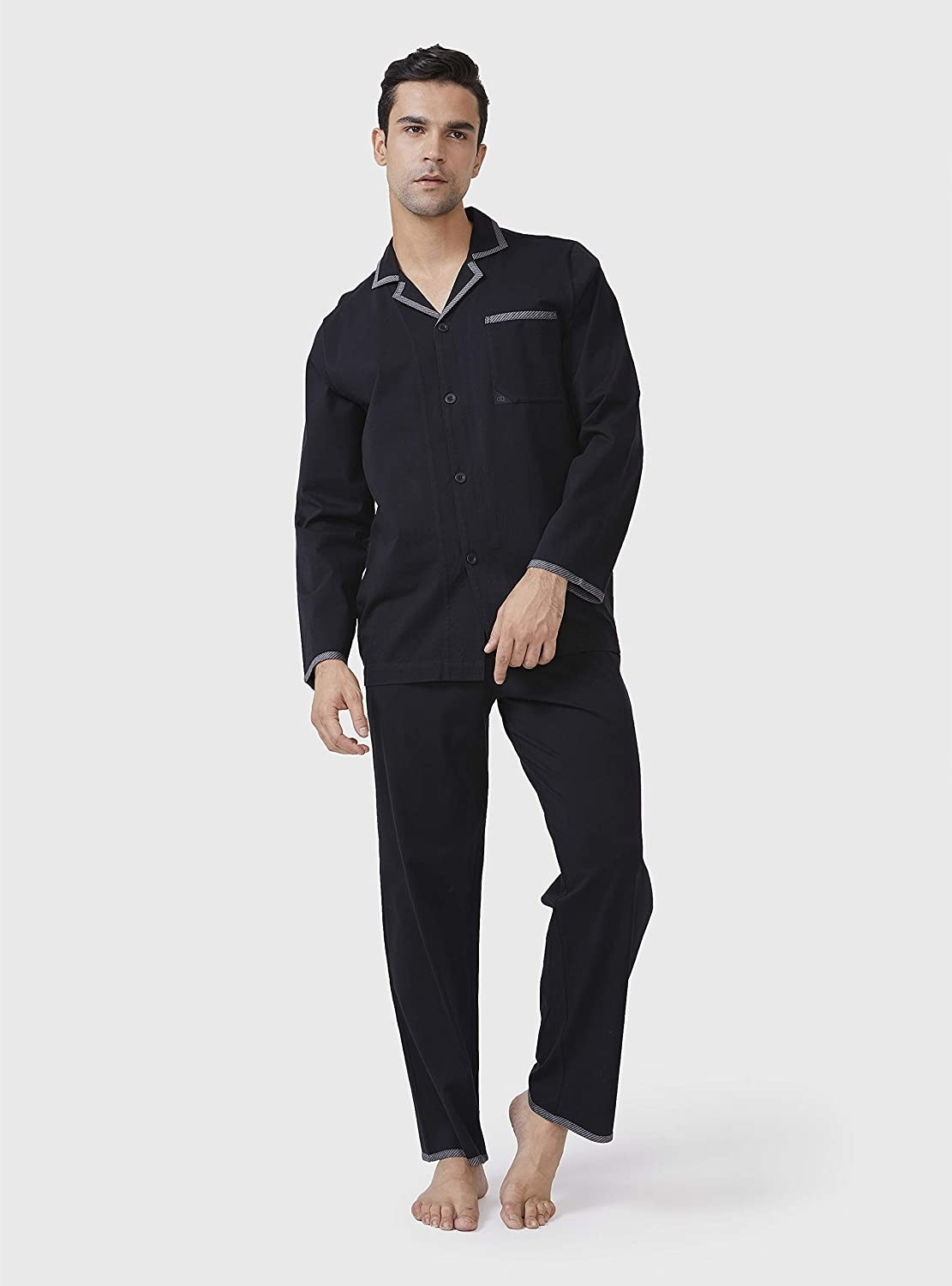 a model in black long sleeve and pants pajamas with gray trim