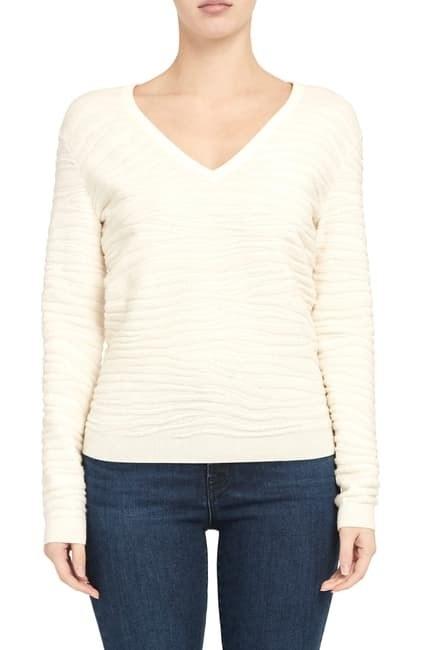 model wearing cream subtle zebra-print sweater with a V-neck