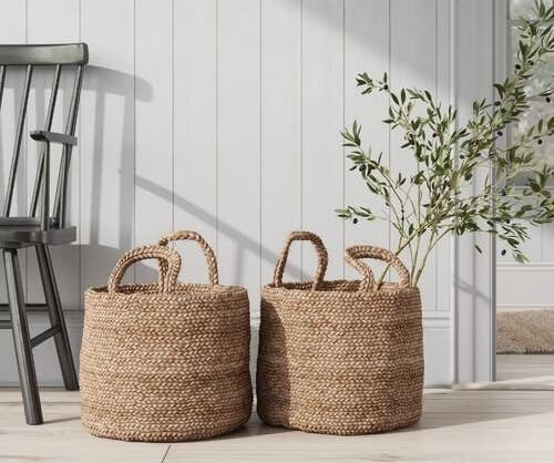 two woven baskets sitting on the floor
