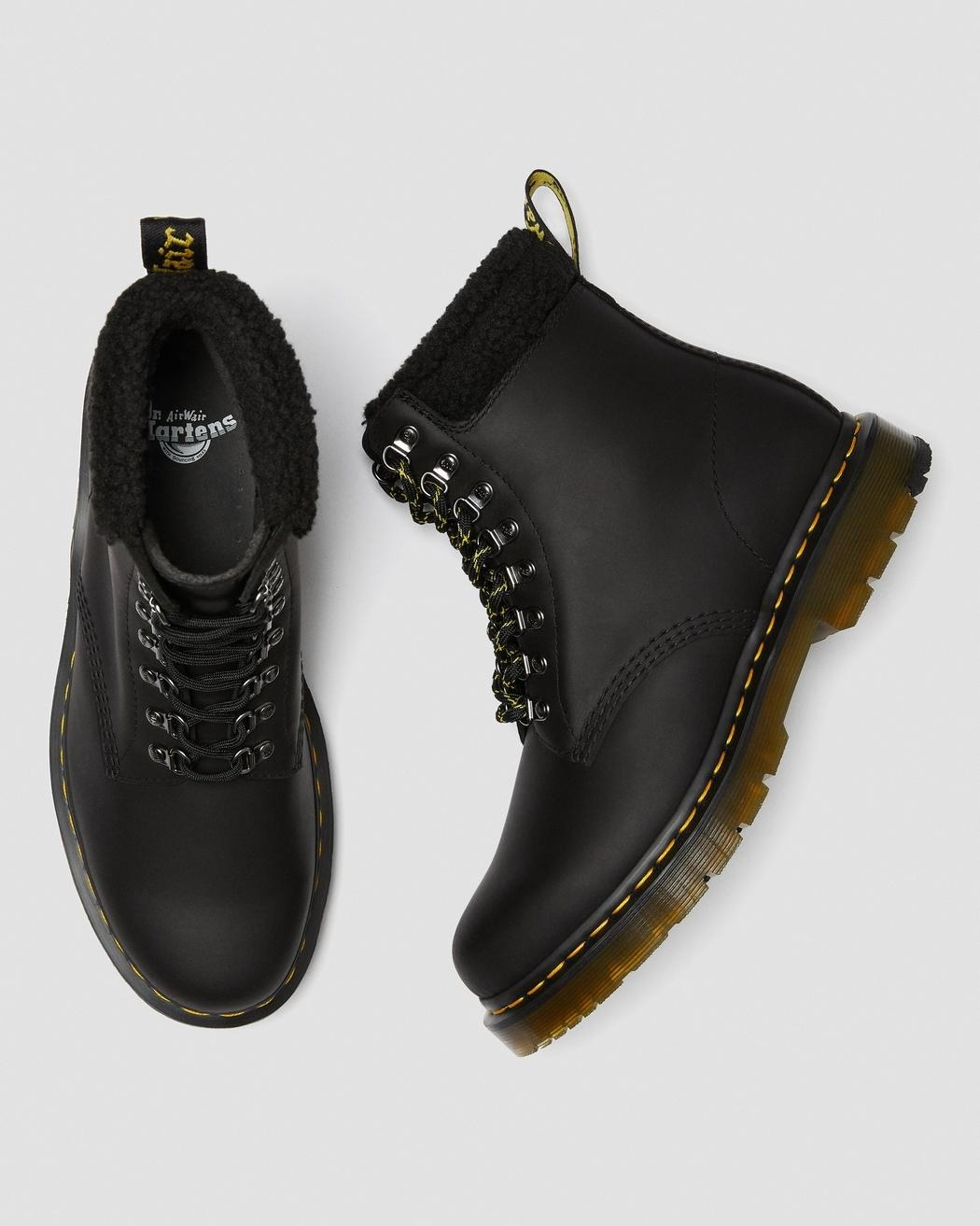 Black Dr. Martens boots with faux-fleece collar accents