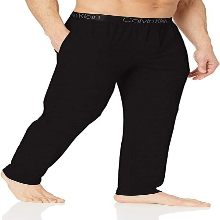 a male model in the pants in black
