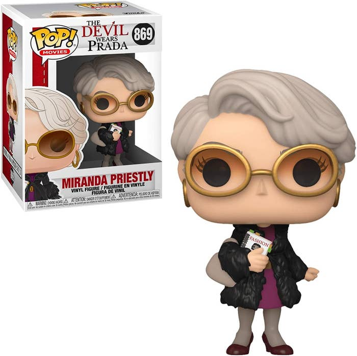 """The Funko Pop carrying the """"book"""" complete with postits"""