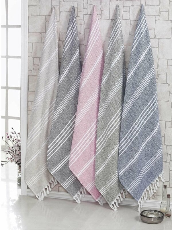 Turkish bath sheets in various colors hanging on the wall