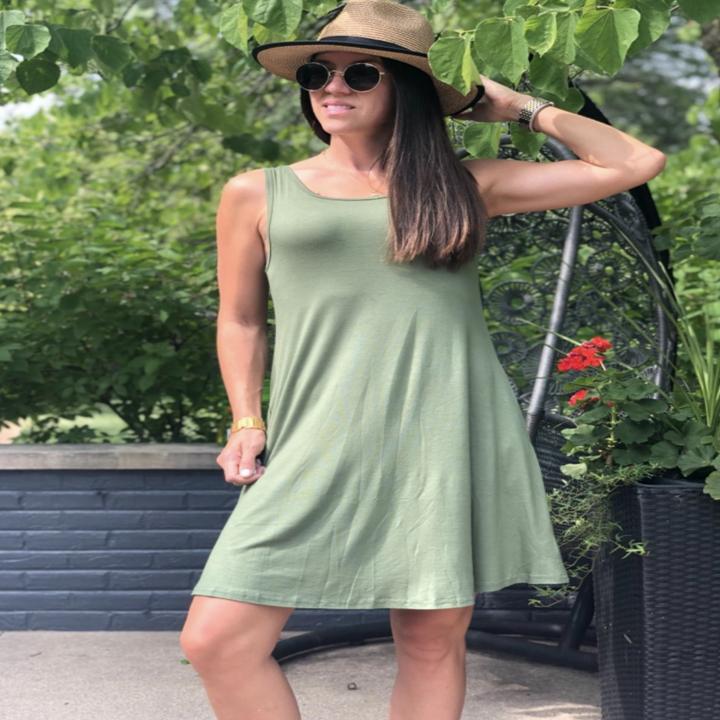 A reviewer wearing the green dress