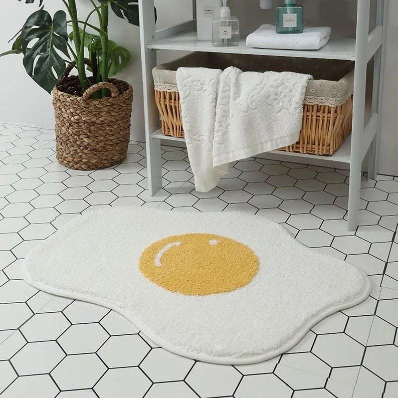 bath mat that looks like an over easy egg