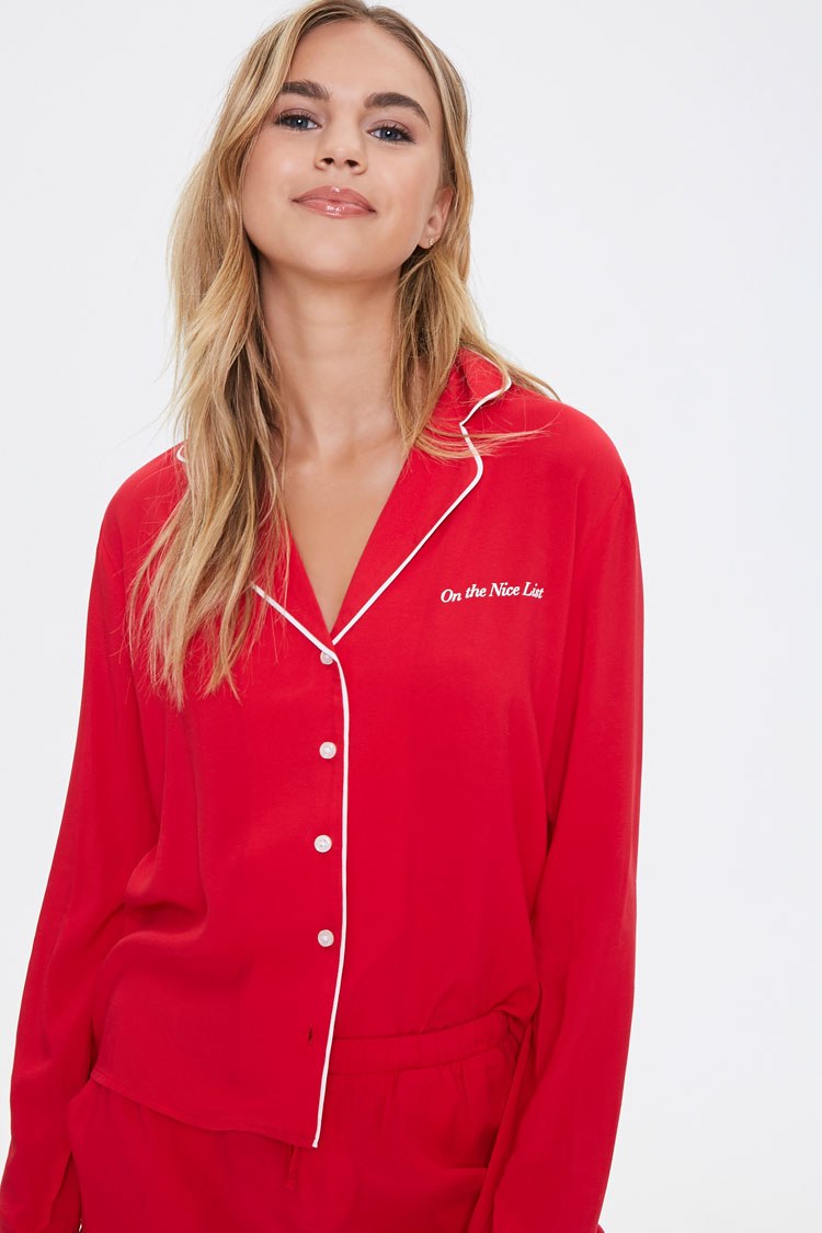 a model in a red long sleeve top with white trim and buttons down the middle and matching red shorts
