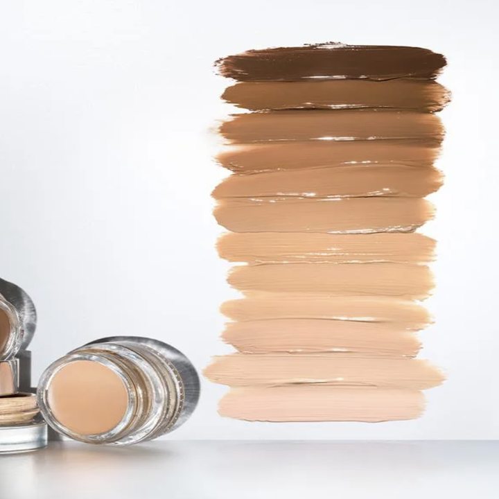 The concealer pot alongside 12 swatches