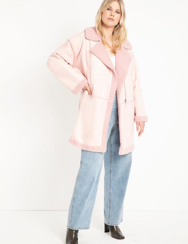Model in the light pink coat