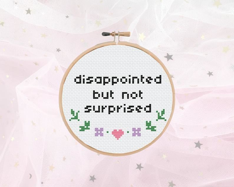 A cross stitch that says disappointed but not surprised