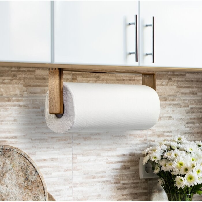 The hanging paper towel holder