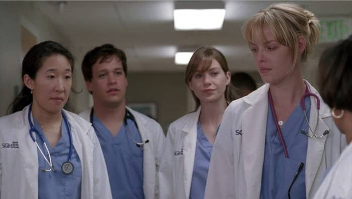 Izzie, Meredith, Cristina, and George looking at Dr. Bailey
