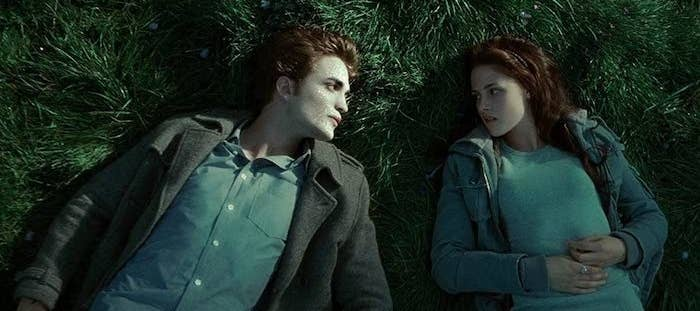 Edward Cullen (Robert Pattinson) and Bella Swan (Kristen Stewart) laying in The Meadow. Edward's skin is glittering.